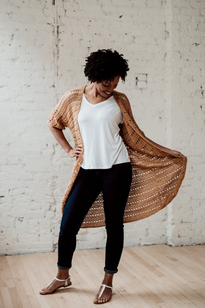 Transport yourself to the island vacation of your dreams when you slip on the Sandbar Cardi, a cotton crochet cardigan pattern from TL Yarn Crafts. Easy stitches and a simple pattern repeat make for a fun, meditative crochet experience. Buy the individual pattern or pick up the all-in-one kit from Lion Brand. | TLYCBlog.com